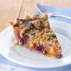 Use summer blueberries and peaches to make a deliciously colorful streusel pie.