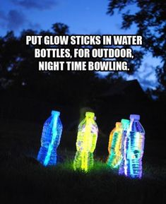 Glowsticks in water bottles = nighttime bowling! How fun for our summer camp out night for the kids!