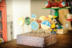 Fantastic Cookie Pops at a Superhero Squad themed birthday party Full of Fabulous Ideas via Kara's Party Ideas | Cake, decor, favors, recipes, printables, and MORE! KarasPartyIdeas.com #Superhero #SuperheroSquad #BirthdayParty #PartyIdeas #cookies