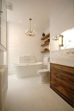 White brick and raw wood bathroom