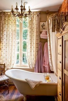 cottage style romantic bathroom with beautiful tub