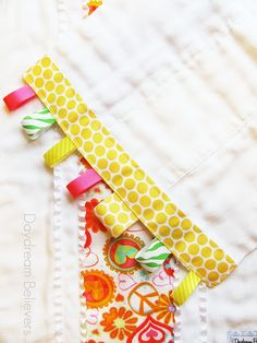 DIY Burp Clothes with taggie ribbon ends-these are super cute!! I make blankets with ribbon ends, but never thought of burp cloths!
