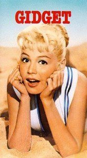 """Gidget (1959) - Sandra Dee, James Darren & Cliff Robertson - Due to an accident while swimming in the sea, Francis meets the surfer Moondoggy. She's fascinated of his sport and starts to hang out with his clique. Although they make fun of her at first, they teach her to surf. Soon she's accepted and given the nickname """"Gidget"""". But it's hard work to become more than a friend to Moondoggy."""