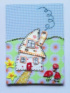 handstitched embroidered textile picture of my daughter's house drawing