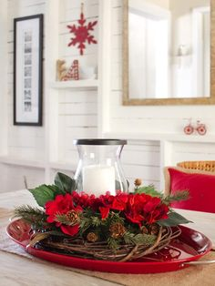 15-Minute Centerpiece—Putting together a beautiful holiday centerpiece doesn't have to be difficult or break the bank. This one is made up of a few elements you might even have around the house, like a grapevine wreath form and a glass candleholder.