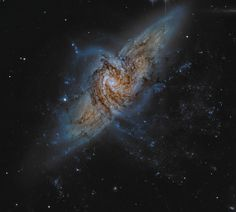 Meet NGC 3314: a galaxy found in the constellation of Hydra more than 140 million light-years from Earth ...