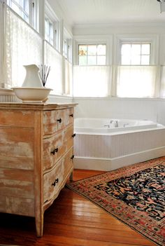 oh that tub. oh that refinished dresser!