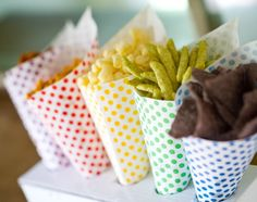 polka dot paper nut and popcorn party cones in red, yellow, green, blue, and purple