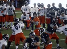 Quarterback Josh McCown runs plays during Chicago Bears minicamp in the Walter Payton Center at Halas Hall. — Brian Cassella, Chicago Tribune, April 16, 2013