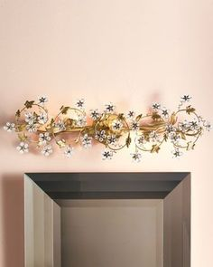 Floral Light Fixture at Horchow. Would look great over any vanity mirror