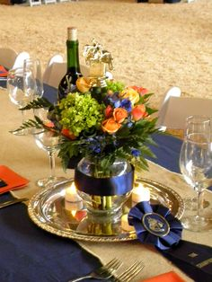 Heirloom trophies and custom rosettes personalized the Champion wedding.