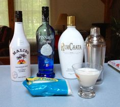 Coconut Cream Pie....one shot of Malibu and Rum Chata and two shots of the whipped and topped off with a pinch of coconut!