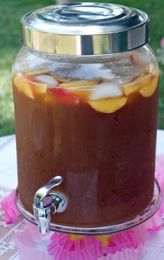 Summer Peach Tea Punch   (3 family-size tea bags   2 cups loosely packed fresh mint leaves   1 (33.8-oz.) bottle peach nectar   1/2 (12-oz.) can frozen lemonade concentrate, thawed   1/2 cup Simple Sugar Syrup   1 (1-liter) bottle ginger ale, chilled   1 (1-liter) bottle club soda, chilled   Garnish: fresh peach wedges)
