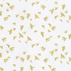 White and Gold Birds Fabric by the Yard I Carousel Designs.  These sweet birds in flight feature a stunning gold metallic on an off-white background. Printed on a soft 100% cotton its sure to become one of your favorite bedding items.