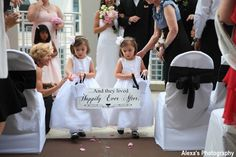 How cute would your flower girls look carrying this sign down the aisle after you and your honey are pronounced husband and wife?!