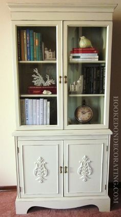 Vintage china cabinet reinvented into a book cabinet.