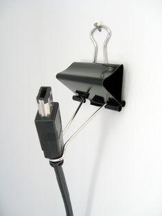 Binder clip cable holder, via Flickr.
