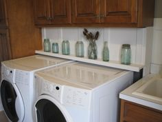 how to hide power plugs behind washer/dryer...build a hinged shelf!