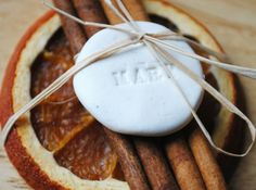 This holiday season, make personalized place settings with dried orange and cinnamon sticks.