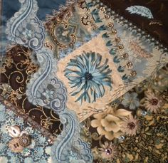 love this blue and brown - and the needle work of course