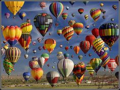 The Albuquerque, New Mexico balloon festival, known as the Albuquerque International Balloon Fiesta®, is the world's largest hot air ballooning event. For nine days during the first full week of October, hundreds of colorful balloons float above the city each morning as dawn breaks over the Sandia Mountains. It's no wonder this visual feast is said to be the world's most photographed event.
