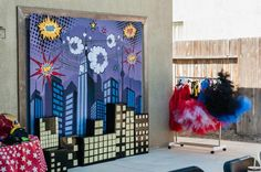 Love this backdrop at a Superhero Party with Lots of Fun Ideas via Kara's Party Ideas | KarasPartyIdeas.com #Superhero #PartyIdeas #PartySupplies #PartyBackdrop