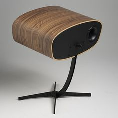 walnut veneer wrapped Ray speakers, from Danish manufacturers, Davone   reminiscent of the Eames lounge chair