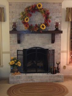 This was just a red brick fireplace - thanks to Pinterest, I finally got the nerve to paint it.  I used latex paint (25% paint to 75% water). Valspar Dove White.  I can't believe how nice it looks and how easy it was.  Thanks to all who pinned their ideas - it gave me courage!