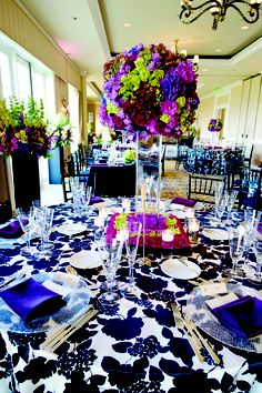 Floral tablecloths and dramatic centerpieces make a bold statement.
