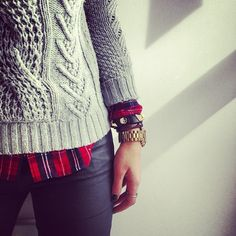 Fall / winter - street & chic style - gray chunky cable knit sweater + red plaid shirt + leather pants