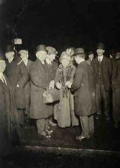 """Picture shows a group of Titanic survivors after they left the Carpathia."""""""