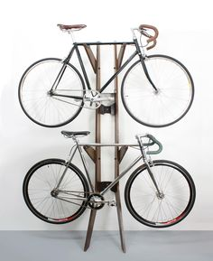 Since the bike is one of our basics in holland, we better store it instyle. Hood and Branchline Bike Stands by Quarterre