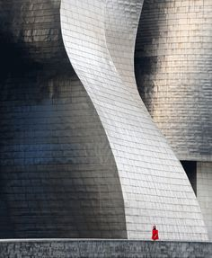 """Bilbao Guggenheim Museum by Maciej Hermann: """"The elephant and a red ant"""""""