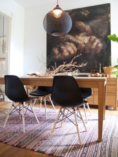 black eames chairs with timber table. love that rug and pendant.