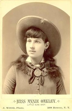 "Annie Oakley ~She could split a playing card edge and put six holes in it before it touched the ground with a .22 rifle from 90 feet away. Born into poverty in Ohio, Annie began hunting at age six to support her siblings and widowed mother before rising to fame as a sharp shooter with ""Buffalo Bill's Wild West Show"" in 1885. During her career she performed for Presidents, Queens and taught upwards of 15,000 women how to use a gun."