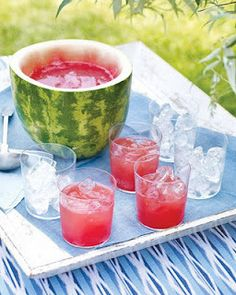 Watermelon Punch and clever punch bowl.  Vodka?