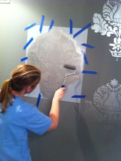 How to stencil a room.  Use matte paint for the walls and metallic paint for the stencil with a foam roller brush. Easy to do and great crisp stencils every time.