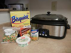 Crockpot Chicken Pot Pie! 1 envelope chicken gravy mix 1 can chicken broth 1 lb. skinless, boneless chicken breast, cut into bite-size pieces 1 bag frozen mixed veggies 1/2 cup sour cream 1 T flour 1 1/2 cup Bisquick 4 med. green onions, chopped (1/4 cup) 1/2 cup milk 4-5hrs