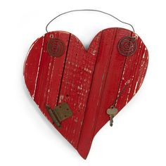 Show off your heart. Artisans craft the charmingly rustic Reclaimed Wood Heart in Red from layered antique bead board and barn wood. The wood is assembled, then cut into a pretty heart shape and decorated with random bits of reclaimed hardware like keys, cabinet pulls and window catches. Each piece is unique and hangs from a hand-twisted reclaimed tin wire. Made from 100% reclaimed materials.