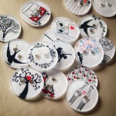 buttons made from shrinky dinks!  I will make these!  The tutorial is here:  http://ohilikethat.blogspot.com/2009/07/how-to-make-your-own-personlised.html