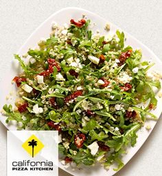 Serve up one of California Pizza Kitchen's restaurant inspired Quinoa & Arugula Salad to pair perfectly with your pizza at home.
