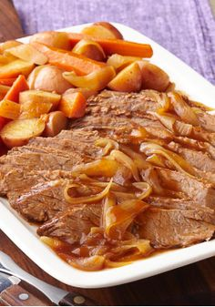 Slow-Cooker Barbecue Beef Brisket – When it comes to barbecue beef brisket, slow and stead wins the race. In this slow-cooker dish, it's prepared with carrots, onions and red potatoes.
