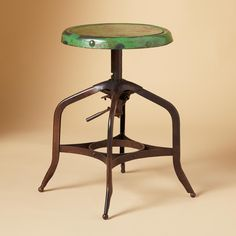 """TEXAS SPINNING STOOL--Discovered at a Texas antique fair, our iron spinning stool reproduces the charm and utility of the original, including the mechanism that elevates the revolving seat. Imported. Exclusive. 15-1/2"""" dia. x 17-1/4""""H"""