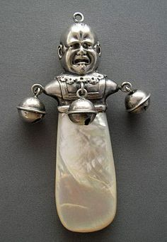 RARE 19TH CENTURY CRYING BABY STERLING SILVER RATTLE
