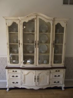 Great idea to refinish a dated china cabinet. i like the dark top on the buffet. it's a nice contrst and something to consider as i look for a china hutch to paint.