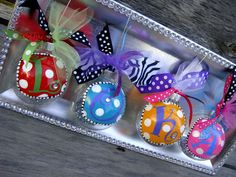Clear ornaments, paint pens, glitter, and ribbon