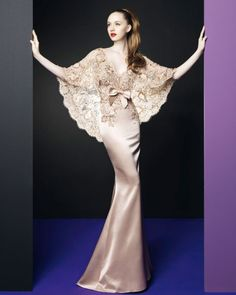 Oh. My. God. Beyond gorgeous. Beyond beyond. This was a dress made for the mother of the bride at a wedding! It strikes me more like a 1930s gown, it is way too beautiful for this century....