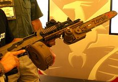 Yeah, that's an AK47 with a chainsaw attachment.......I must have this!!!!!!