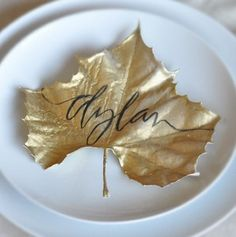 Spray paint leaves from craft store gold and write names on them for Thanksgiving seating arrangements