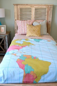 cute shutter headboard and I love the map quilt on the bed